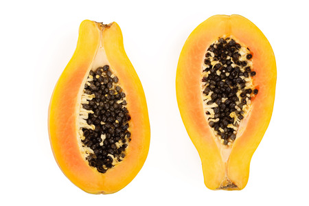 half of ripe papaya isolated on a white background. Top view. Flat lay