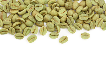 green coffee beans isolated on white background with copy space for your text. Top view. Flat lay