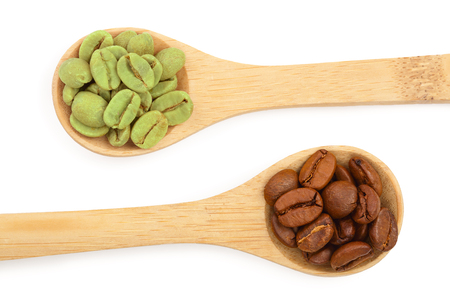 green and brown coffee beans in wooden spoon isolated on white background close up. Top view. Flat lay 版權商用圖片