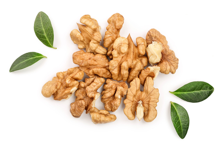 peelled Walnuts with leaves isolated on white background. Top view. Flat lay. Stock Photo