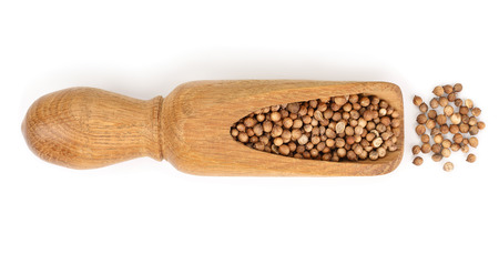 Cumin or caraway seeds in wooden spoon isolated on white background. Top view Фото со стока
