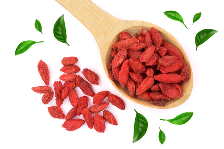 Dried goji berries in wooden spoon Isolated on white background.