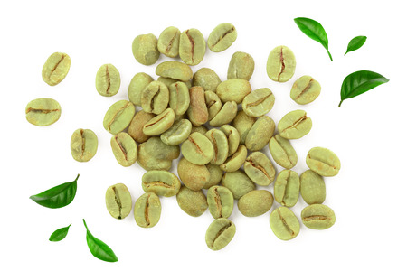 green coffee beans isolated on white background close up. Top view. Flat lay Stock Photo