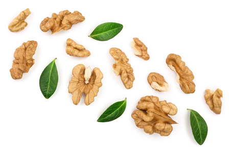 peelled Walnuts with leaves isolated on white background with copy space for your text. Top view. Flat lay