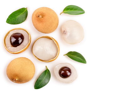 Fresh longan fruit with leaves isolated on white background. Top view. Flat lay Banco de Imagens