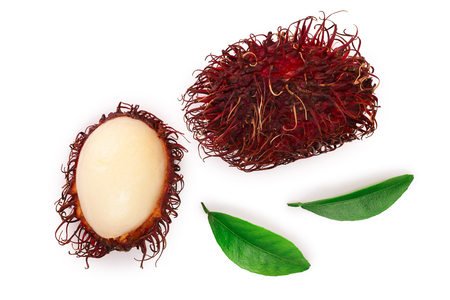 rambutan with leaves isolated on white background. Tropical fruit. Nephelium lappaceum. Top view. Flat lay Stock Photo