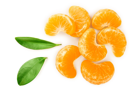 tangerine or mandarin slices with leaves isolated on white background. Top view. Flat lay.