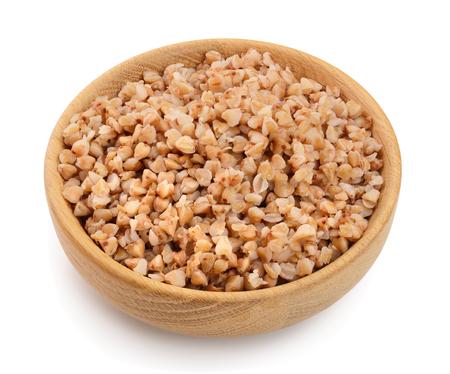 Buckwheat porridge in wooden bowl isolated on white background. Archivio Fotografico