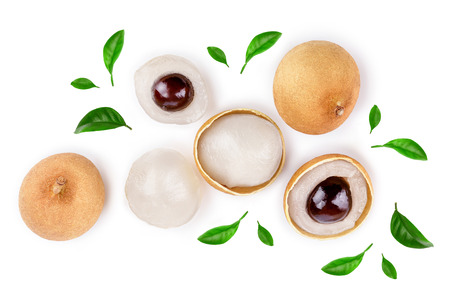 Fresh longan fruit with leaves isolated on white background. Top view. Flat lay.