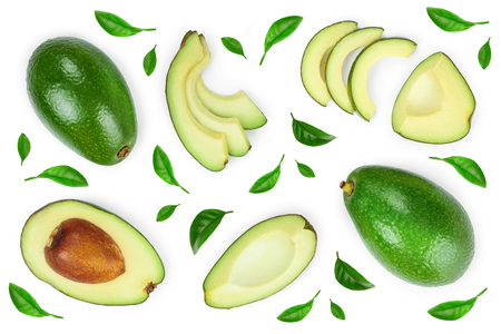 avocado and slices decorated with green leaves isolated on white background. Top view. Flat lay