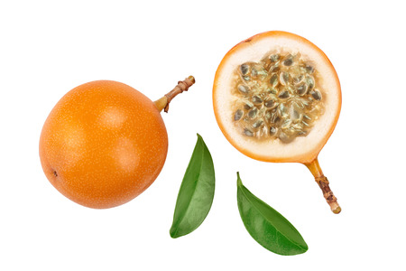 Granadilla or yellow passion fruit with leaf isolated on white background. Top view. Flat lay