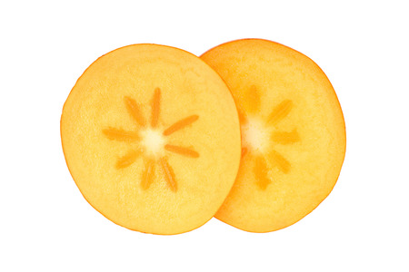 slice of Persimmon fruit isolated on white background close-up. Top view. Flat lay.