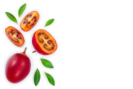 Fresh tamarillo fruit with leaves isolated on white background with copy space for your text. Top view. Flat lay.