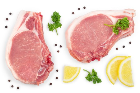 sliced raw pork meat with parsley and lemon isolated on white background. Top view. Flat lay.