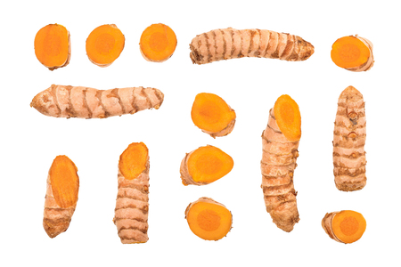 turmeric root and slices isolated on white background. Top view. Flat lay