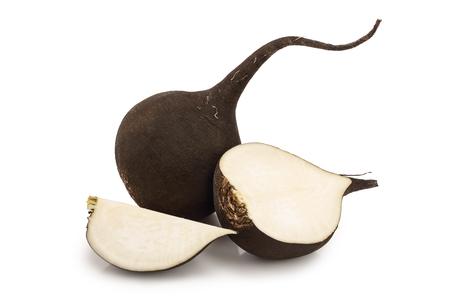 Black radish with slices isolated on white background