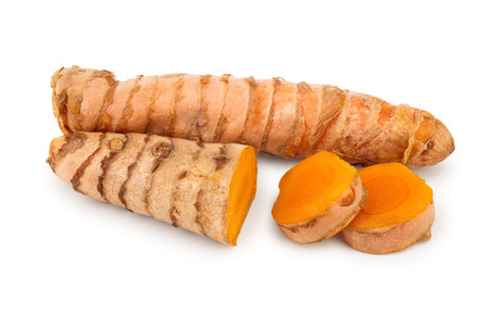 turmeric root and slices isolated on white background.