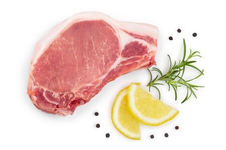 sliced raw pork meat with rosemary and lemon isolated on white background. Top view. Flat lay