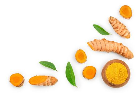 Turmeric powder and turmeric root isolated on white background with copy space for your text. Top view. Flat lay.