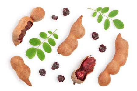 Tamarind fruit with leaf and seed isolated on white background, Top view. Flat lay.