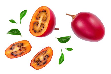 Fresh tamarillo fruit with leaves isolated on white background. Top view. Flat lay