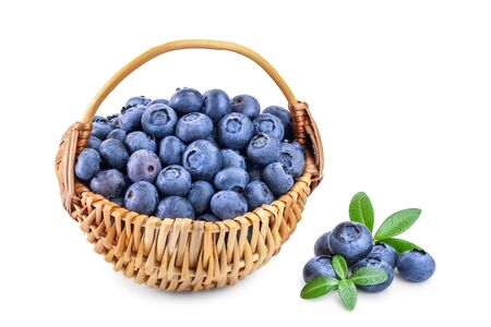 fresh ripe blueberry in wooden basket isolated on white background