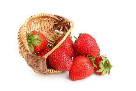 strawberries in a wicker basket isolated on white background Stockfoto - 128619395