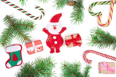 Christmas background with fir branches and Santa Claus isolated on white background. Top view. Flat lay. 写真素材 - 129444181