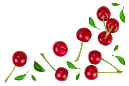 Some cherries with leaf closeup isolated on white background. With copy space for your text. Top view. Flat lay Stock Photo