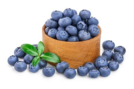 fresh ripe blueberry in wooden bowl isolated on white background