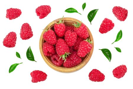 raspberries in wooden bowl with leaves isolated on white background. Top view. Flat lay 스톡 콘텐츠