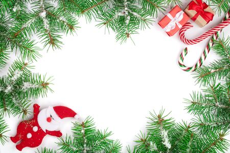 Christmas Frame of Fir tree branch with candy canes and snow isolated on white background with copy space for your text Stock fotó