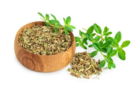 Dried thyme leaves in the wooden bowl, with fresh thyme isolated on white background