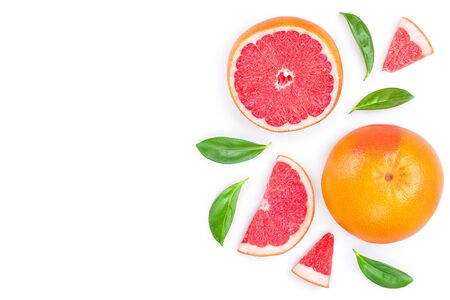 Grapefruit and slices with leaves isolated on white background with copy space for your text. Top view. Flat lay pattern