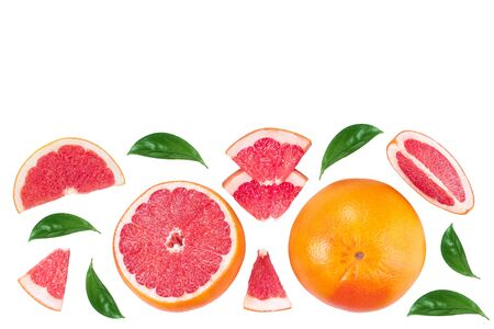 Grapefruit and slices with leaves isolated on white background with copy space for your text. Top view. Flat lay pattern. Imagens