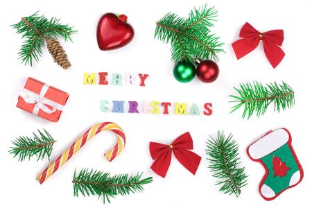 Christmas background with merry christmas inscription decorated with fir branches isolated on white background. Flat lay