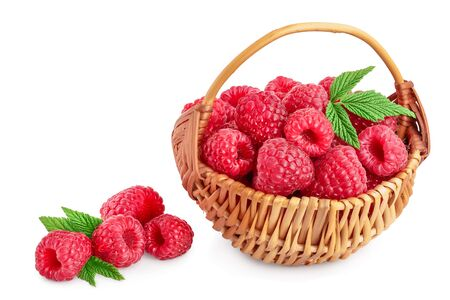 Ripe raspberries with leaf in a wicker basket isolated on white background.