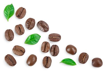 Heap of roasted coffee beans with leaves isolated on white background with copy space for your text. Top view. Flat lay. Фото со стока