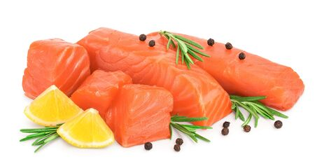 raw salmon piece cube with rosemary, lemon and peppercorn isolated on white background close up.