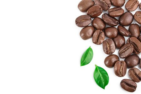 roasted coffee beans with leaves isolated on white background with copy space for your text.