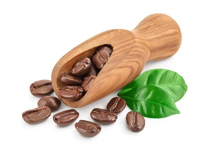 Heap of roasted coffee beans in wooden scoop with leaves isolated on white background Фото со стока