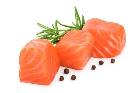 raw salmon piece cube with rosemary and peppercorn isolated on white background close up