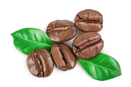 roasted coffee beans with leaves isolated on white background