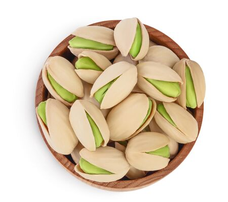 pistachio in wooden bowl isolated on white background with clipping path and full depth of field. Top view. Flat lay