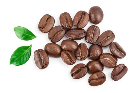 Heap of roasted coffee beans with leaves isolated on white background. Top view. Flat lay.