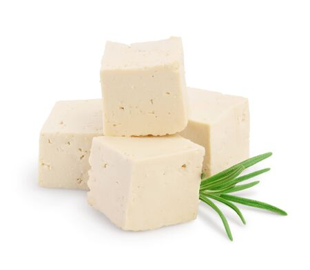 Heap of diced tofu cheese isolated on white
