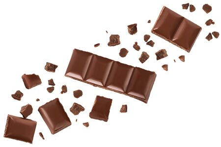 Pieces of chocolate isolated on white background. Top view with copy space for text. Flat lay.