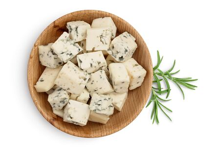 diced Blue cheese in wooden bowl isolated on white background with clipping path and full depth of field. Top view. Flat lay.