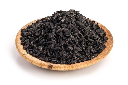 Nigella sativa or Black cumin in wooden plate isolated on white background