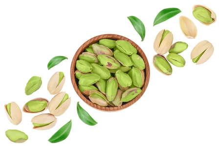 pistachio in wooden bowl isolated on white background with clipping path and full depth of field. Top view. Flat lay Imagens